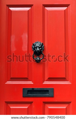 Close-up View of a Traditional Style Red Front Door of an Upscale English Town House