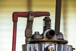 Close-up view of a vintage agricultural engine. Farming machinery part with different details. Antique farming technology in the museum of Kootenays, British Columbia, Canada