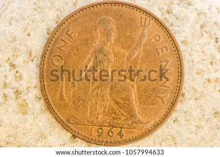 Close up view of aged coin showing fine design details engraved on coin metal #1057994633