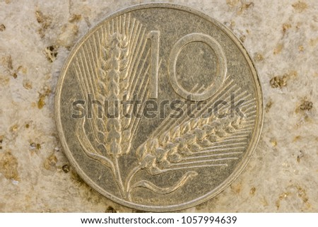 Close up view of aged coin showing fine design details engraved on coin metal #1057994639