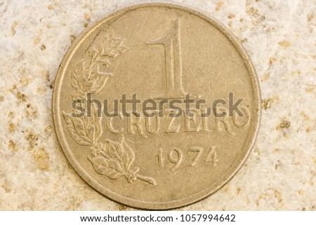 Close up view of aged coin showing fine design details engraved on coin metal #1057994642