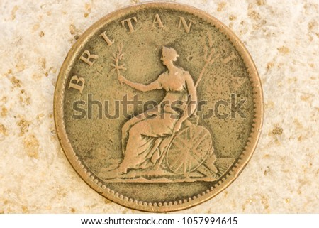 Close up view of aged coin showing fine design details engraved on coin metal #1057994645