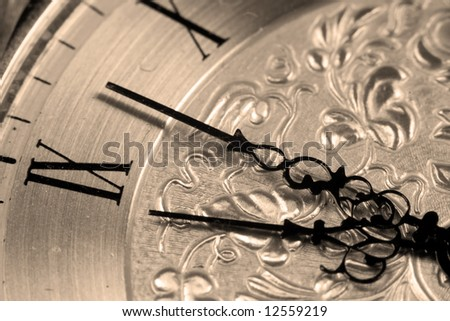 Close up view of an antique clock face with hour and minute hands