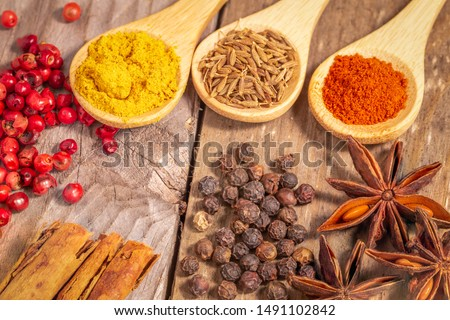 close up view of an assortment of spices on a rustic table