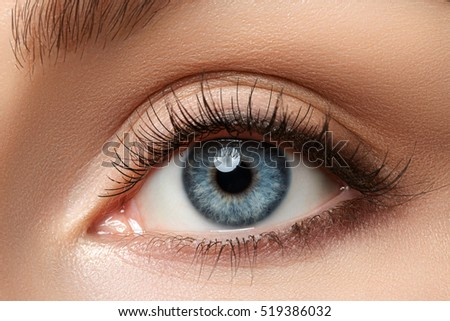Close up view of beautiful blue female eye. Good vision, contact lenses, trust or observation concept