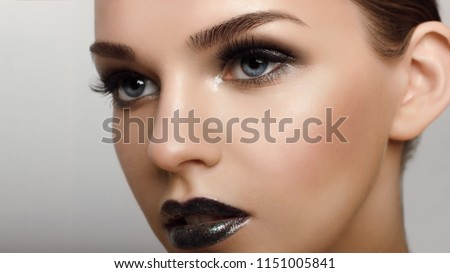 Close up view of beautiful blue female eyes. Perfect trendy eyebrow and with extreme long eyelashes. Good vision, contact lenses, brow bar or fashion eyebrow makeup concept