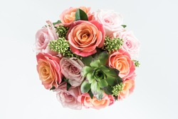 Close-up view of beautiful bouquet of roses and succulents isolated on white