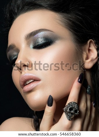 Shutterstock Close up view of beautiful woman touching her face. Perfect skin and evening makeup. Studio shot. Sensuality, passion, trendy youth makeup or cosmetology concept.