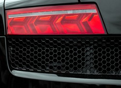 Close-up view of black sports car rear light.