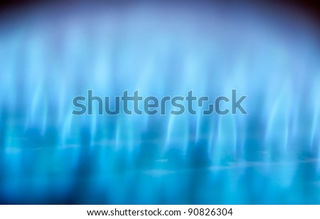 Close-up view of blue flames in gas boiler