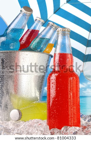 Close-up view of bottles with ice at the beach