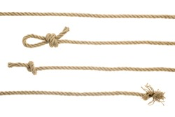 close-up view of brown nautical ropes with knots isolated on white