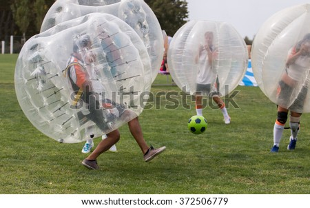 Close up view of bubble football balls game.