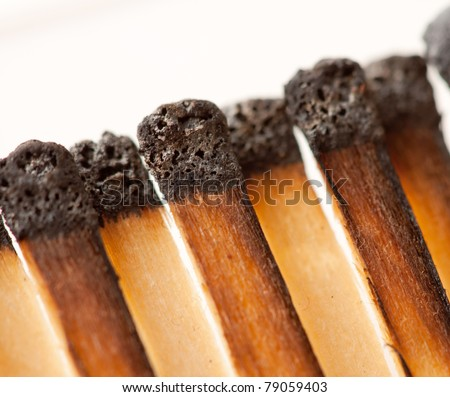 Close-up view of burned wooden matches in matchbook