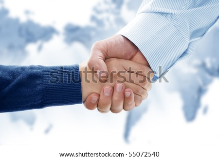 Close up view of business people handshake in office environmeny