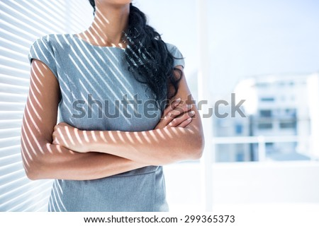 Close up view of businesswoman with arms folded in the office