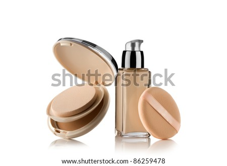 Close up view of Cosmetic liquid foundation  with powder on white back