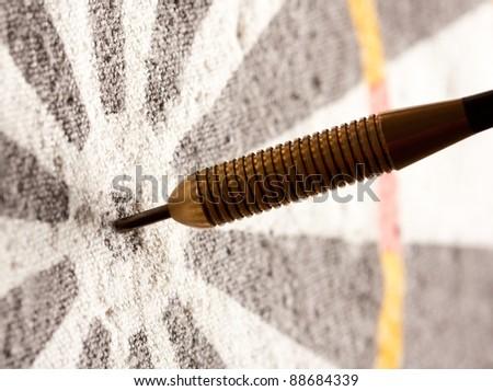 Close-up view of darts in bullseye on dartboard