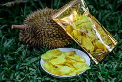 Close-up view of durian meat that has been fried in a sheet and has a delicious yellow color, can be put into a bag for sale or stored for later.