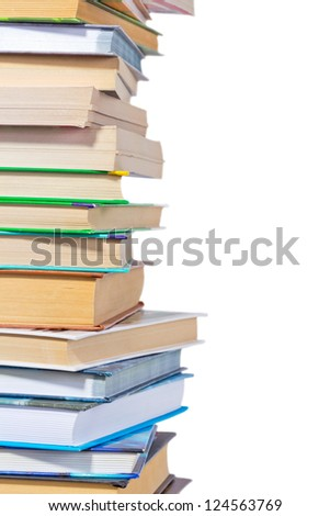 Close-up view of edge of big pile of books isolated on white background