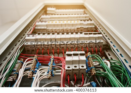 Close up view of electrical panel with fuses and contactors.