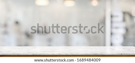 Close up view of empty marble counter in glass partition