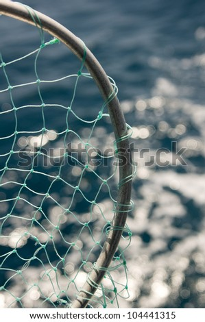 Close up view of fishing net over the water