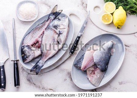 close-up view of fresh raw healthy sea bream fish filet with lemon and herbs Сток-фото ©