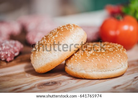 close up view of freshly baked bread for burgers on wooden tabletop #641765974