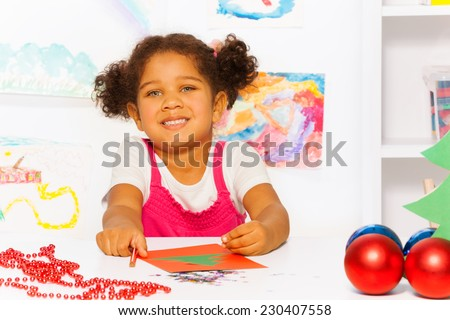 Close up view of girl with Christmas carton card