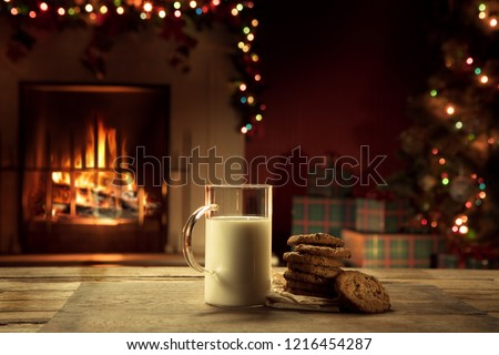 close up view of glass of milk with cookies on color back #1216454287