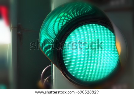 Close up view of green color on the traffic light. #690528829
