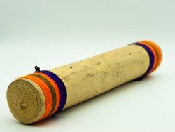 Close up view of handmade wooden rain sticks on a white background. Peruvian instrument. Ambient sound. Concept percussion instruments.