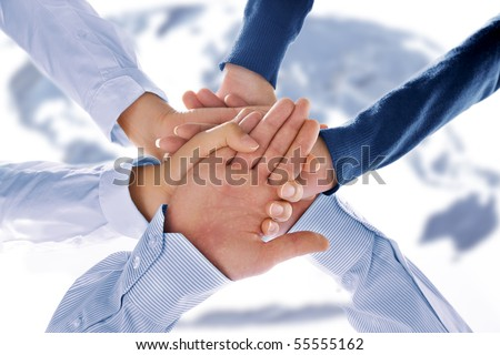 Close up view of hands getting together in office environment - stock photo