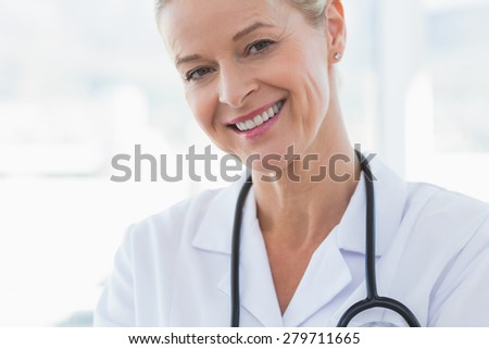 Close-up view of happy doctor looking at camera in hospital