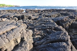 Close-up view of hardened lava flow near the ocean on the Big Island of Hawaii