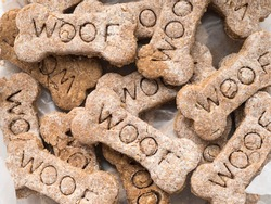 Close-up view of home made dog treats with the word Woof