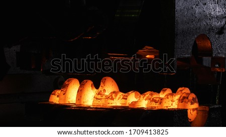 Close up view of hot steel forging process with big mechanical hammer machine and red hot billet. Scene. Industrial details of metallurgic factory or plant. Stock fotó ©