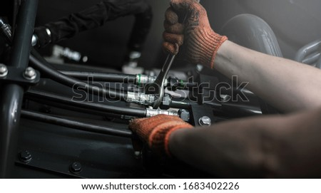 Close up view of hydraulic pipes of heavy industry machine. Low key. Hydraulic maintenance concept. Photo stock ©
