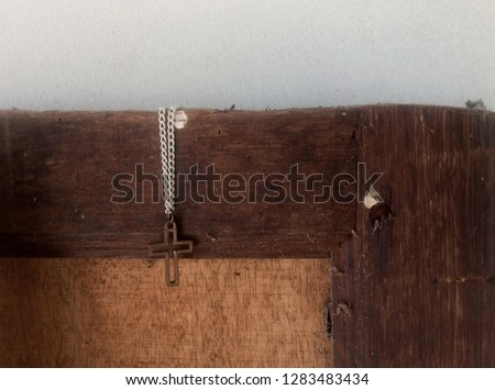Close up view of Jesus christ cross christian praying for life symbol on old vintage grunge wood door concept picture loving God with selective focus