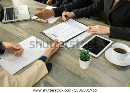 Close up view of job interview in office, focus on resume writing tips, employer reviewing good cv of prepared skilled applicant, recruiter considering application, hr manager making hiring decision.