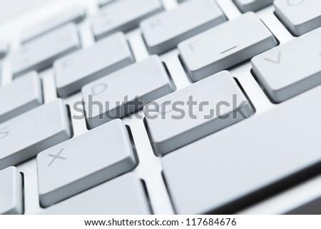 Close up view of keys of white laptop keyboard