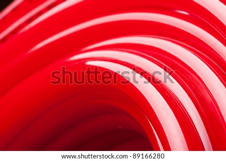 Close-up view of long red water pipe