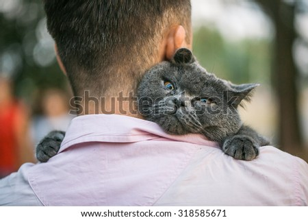 close up view of man holding a...