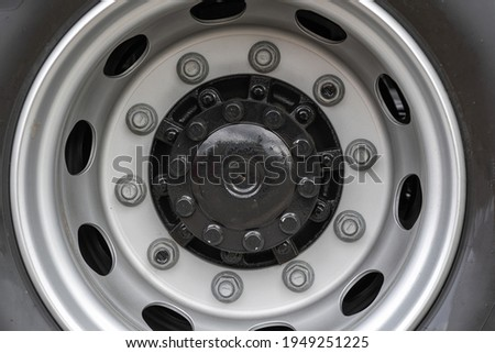 Close up view of metal bolt on new wheel. Concept of maintenance agrarian machinery. Replace and fixing locking hubs Foto stock ©