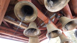 Close-up view of metal orthodox church bells. Bottom view of the Church bells