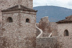 Close-up view of Momcilov grad fortress in Pirot, Serbia and background mountain peak Crni vrh with antenna towers