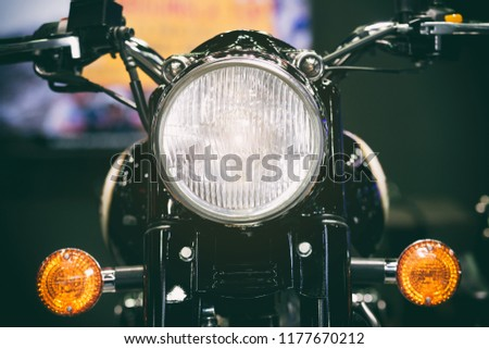 Close-up view of motorcycle headlight. Vintage classic Motorcycle headlight or head lamp.