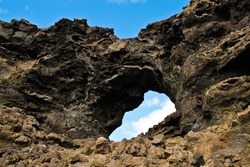 Close up view of natural window formed by lava rock in Dimmuborgir lava field lake myvatn Iceland
