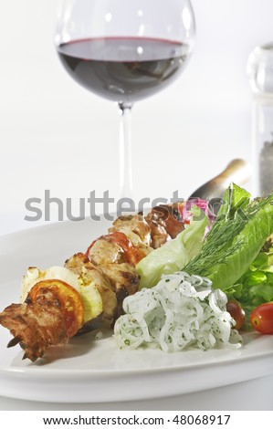 Close up view of nice delicious shish kebab on white back